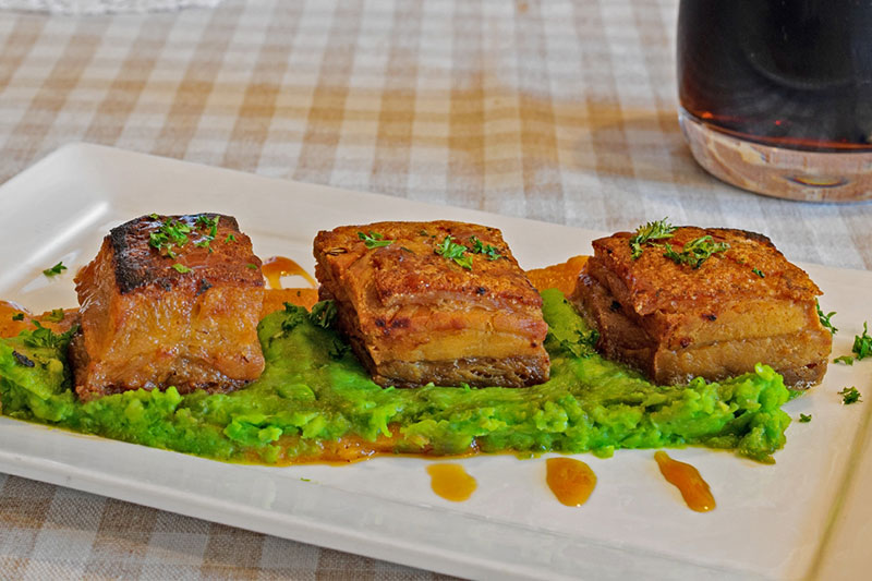 PORK BELLY WITH MUSHY PEAS AND SPICED POTATO PUREE
